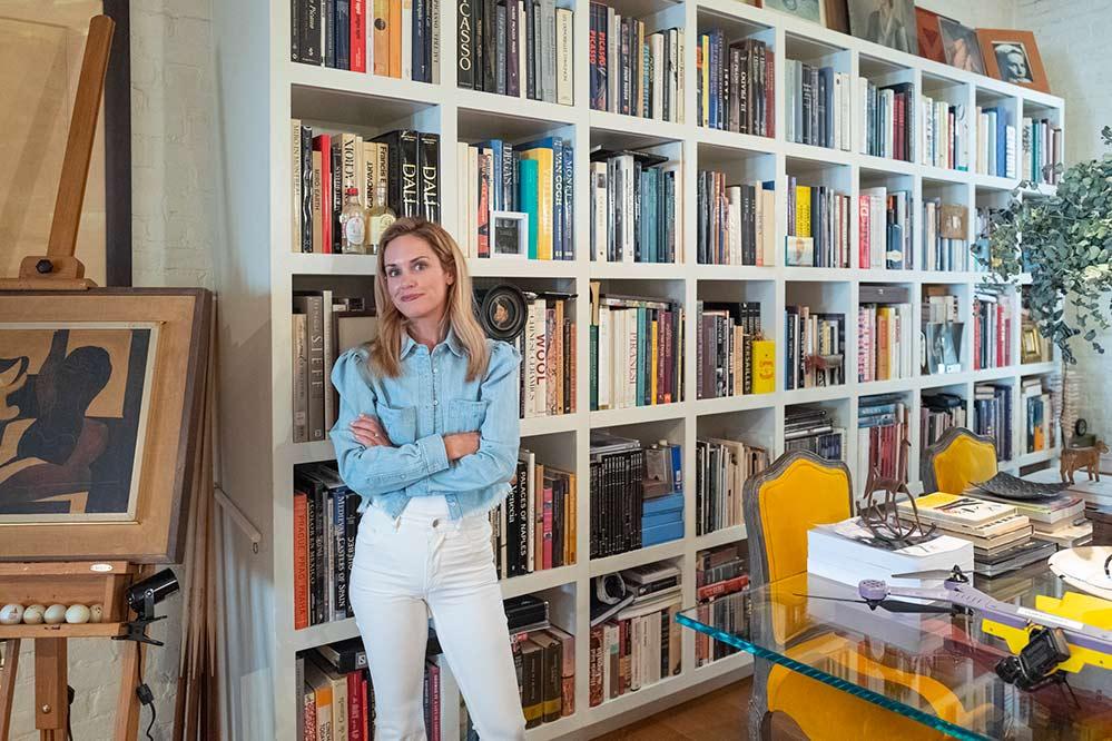Kj Standing In A Room Near Books